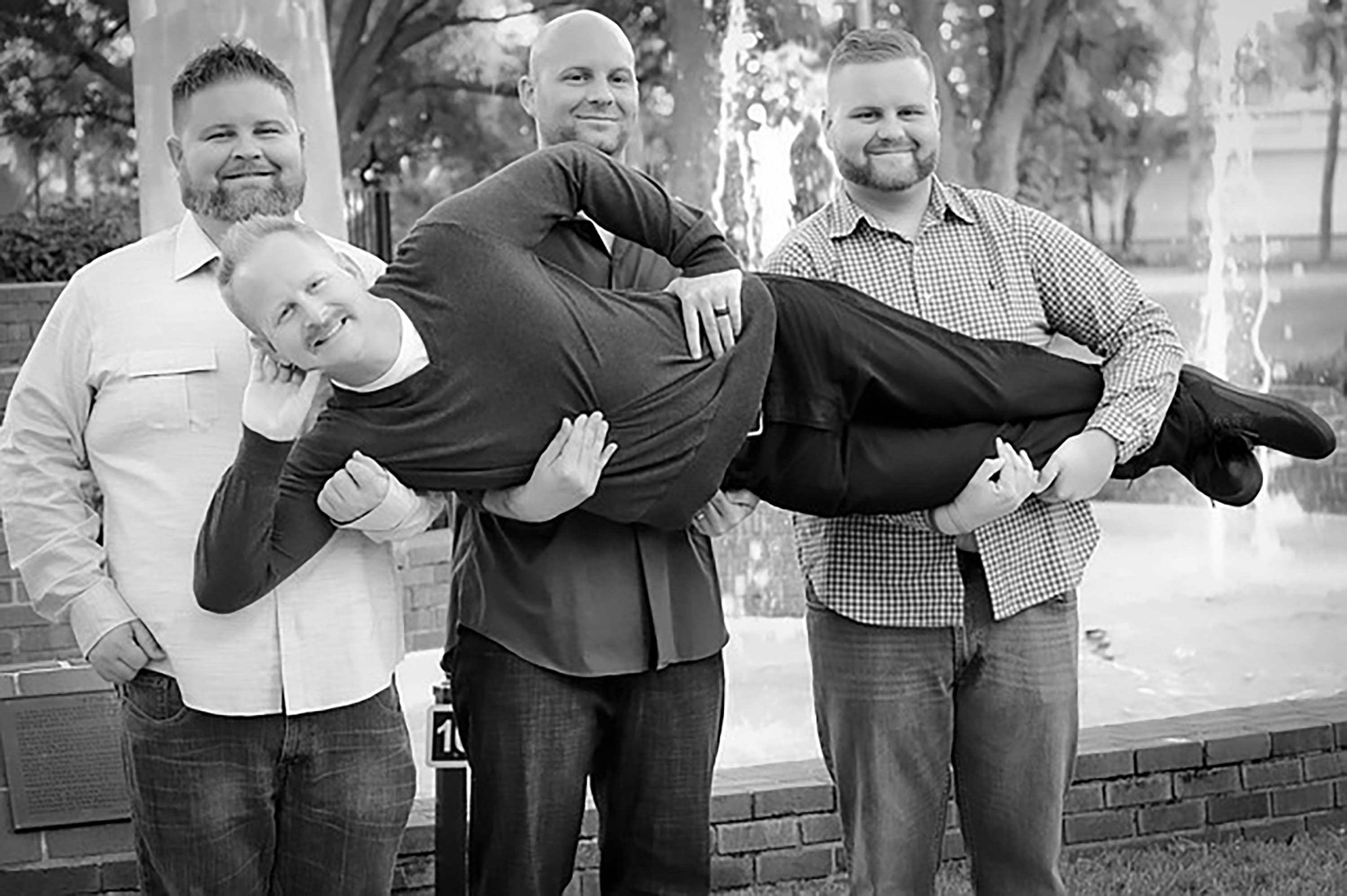 male teacher group being silly